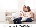 smiling young couple relaxing... | Shutterstock . vector #744302416