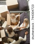 happy family packing unpacking... | Shutterstock . vector #744304723