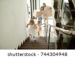 happy children going upstairs... | Shutterstock . vector #744304948