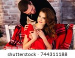 man hugging his beautiful... | Shutterstock . vector #744311188