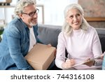 cheerful mature husband and... | Shutterstock . vector #744316108