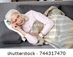 serene mature lady napping on... | Shutterstock . vector #744317470
