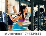 attractive fit girl doing... | Shutterstock . vector #744324658