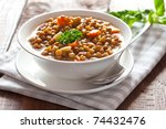 fresh lentil stew in bowl with parsley - stock photo