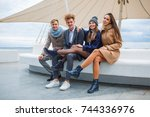 funny young company having fun... | Shutterstock . vector #744336976