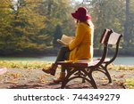 Woman Reading A Book On A Park...