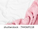 bedding with a pink knitted... | Shutterstock . vector #744369118