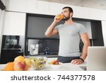 a sporty man stands in the... | Shutterstock . vector #744377578