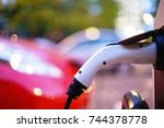 electric vehicle is changing in ... | Shutterstock . vector #744378778