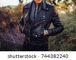 man wearing black leather... | Shutterstock . vector #744382240