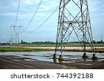 transmission line tower on blue ... | Shutterstock . vector #744392188