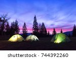 three tents lighted from the... | Shutterstock . vector #744392260
