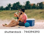 couple drinking beer and having ... | Shutterstock . vector #744394393