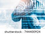 double exposure businessman and ... | Shutterstock . vector #744400924