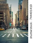 tilt shift view of a crosswalk... | Shutterstock . vector #744401410