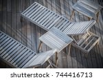 Wooden Cruise Ship Deckchairs Closeup From Above. - stock photo