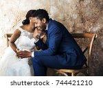 newlywed african descent couple ... | Shutterstock . vector #744421210