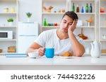 man falling asleep during his... | Shutterstock . vector #744432226
