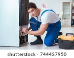 repairman contractor repairing... | Shutterstock . vector #744437950