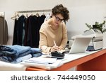 woman working on projects | Shutterstock . vector #744449050