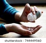 woman taking medicine | Shutterstock . vector #744449560