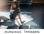 fit adult woman resting in gym... | Shutterstock . vector #744466846