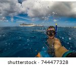 freediver near the two cruise... | Shutterstock . vector #744477328