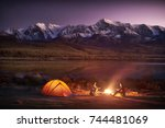 night camping. two men tourists ... | Shutterstock . vector #744481069