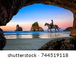 view from the cave of wharariki ... | Shutterstock . vector #744519118
