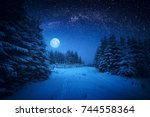 full moon rising above the... | Shutterstock . vector #744558364
