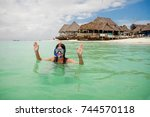 happy woman wearing a mask for... | Shutterstock . vector #744570118