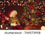 christmas baby open present... | Shutterstock . vector #744573958