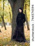 beautiful girl standing near... | Shutterstock . vector #744574594