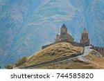 gergeti christian church near... | Shutterstock . vector #744585820