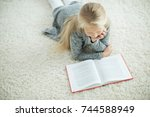 the child is reading | Shutterstock . vector #744588949