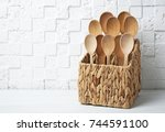 wooden spoons in wicker basket... | Shutterstock . vector #744591100