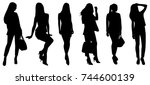 woman silhouettes   Shutterstock .eps vector #744600139