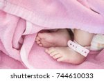 closeup foot of baby with... | Shutterstock . vector #744610033