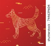 gold dog style tribe on a red... | Shutterstock .eps vector #744639604