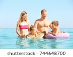 happy family resting at sea... | Shutterstock . vector #744648700