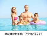 happy family resting at sea... | Shutterstock . vector #744648784