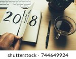 new year 2018 is coming concept.... | Shutterstock . vector #744649924