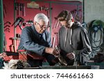 a grandfather teaches his... | Shutterstock . vector #744661663
