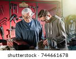 a young apprentice adjusting a... | Shutterstock . vector #744661678