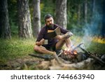 hipster hiker with book and mug ... | Shutterstock . vector #744663940
