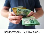 man counting hundreds and... | Shutterstock . vector #744675523