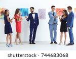 group of people in formal wear... | Shutterstock . vector #744683068