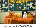 a table with pumpkin jack heads ... | Shutterstock . vector #744685264