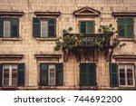 old balcony with trees and... | Shutterstock . vector #744692200