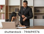 upset woman being scolded by... | Shutterstock . vector #744694576